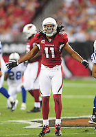 Sept. 27, 2009; Glendale, AZ, USA; Arizona Cardinals wide receiver Larry Fitzgerald reacts in the first half against the Indianapolis Colts at University of Phoenix Stadium. Mandatory Credit: Mark J. Rebilas-