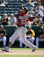 Michael Brantley #23 of the Cleveland Indians bats against the Oakland Athletics in a spring training game at Phoenix Municipal Stadium on March 2, 2011  in Phoenix, Arizona. .Photo by:  Bill Mitchell/Four Seam Images.