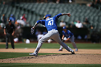 OAKLAND, CA - AUGUST 16:  Peter Moylan #47 of the Kansas City Royals pitches against the Oakland Athletics during the game at the Oakland Coliseum on Wednesday, August 16, 2017 in Oakland, California. (Photo by Brad Mangin)