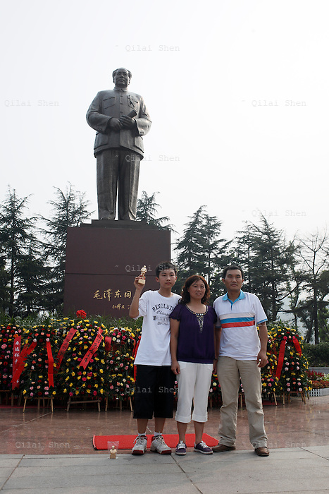 Visitors at the Statue Square near Mao's birthplace in Shaoshan, Hunan Province, China on 12 August 2009.