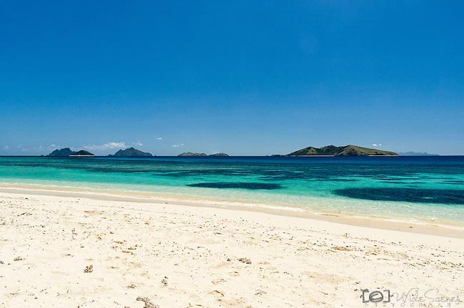 View of the closeby islands in the Mamanuca from North Beach on Mana Island. Mana Island Resort & Spa, Fiji