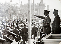 BNPS.co.uk (01202 558833)<br /> Pic: Dickins/BNPS<br /> <br /> Ricthofen with Hitler at the huge Nazi victory parade for the Condor Legion in the heart of Berlin in June 1939.<br /> <br /> The unseen personal photo album of Field Marshal Wolfram von Richthofen, cousin to the legendary Red Baron, which gives an unprecedented insight into his military career in the Third Reich, has been rediscovered.<br /> <br /> Wolfram served in the Red Baron's squadron in the WW1, went on to design the 'Jericho trumpet' of the infamous Stuka Bomber between the wars, before leading the Condor Legion in the Spanish Civil War.<br /> <br /> After the outbreak of WW2 the fascinating album shows Richthofen's lead roll in Operation Barbarossa - the Nazi's suprise invasion of Communist Russia and their race to conquer the vast country before the onset of the notorious Russian winter.<br /> <br /> The two albums were taken from Berlin by a British soldier at the end of the Second World War who kept it for 60 years before it was passed into the hands of a private collector.<br /> <br /> Dickins auctions are selling the historic albums with a &pound;20,000 estimate on 31st March.