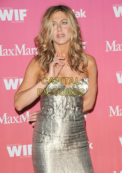 JENNIFER ANISTON .at The Women in Film 2009 Crystal .and Lucy Awards held at The Hyatt Regency Century Plaza in Century City, California, USA, June 12th 2009                                                                     .half length gold silver metallic shiny bustier cleavage strapless hair down wavy hand .CAP/DVS.©DVS/RockinExposures/Capital Pictures