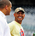 6 June 2010: Cincinnati Reds' shortstop Orlando Cabrera (right) jokes with Washington Nationals director of travel Rob MacDonald prior to a game against the Washington Nationals at Nationals Park in Washington, DC. The Reds edged out the Nationals 5-4 in a ten inning game. Mandatory Credit: Ed Wolfstein Photo