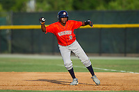 Juan Santana (3) of the Greeneville Astros takes his lead off of first base against the Burlington Royals at Burlington Athletic Park on June 29, 2014 in Burlington, North Carolina.  The Royals defeated the Astros 11-0. (Brian Westerholt/Four Seam Images)