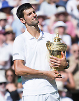 Novak Djokovic (SRB) holds the Wimbledon Gentlemen's singles Trophy, defeating Kevin Anderson (RSA) in straight sets