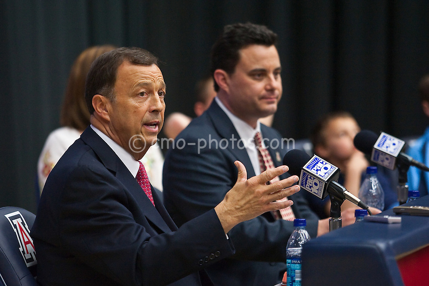 Apr 7, 2009; Tucson, AZ, USA; Arizona Wildcats athletics director Jim Livengood (left) speaks to the media during a press conference to introduce the university's new head basketball coach Sean Miller (right) at the McKale Center.