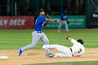 Rancho Cucamonga Quakes shortstop Jeter Downs (15) makes a throw to first base over the Jancarlos Cintron (3) during a California League game against the Visalia Rawhide on April 8, 2019 in Visalia, California. Rancho Cucamonga defeated Visalia 4-1. (Zachary Lucy/Four Seam Images)