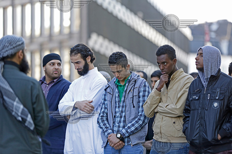 Radical muslims protest  a film mocking Islam outside the US embassy in Oslo, Norway. The gathering was small and passed peacefully.<br /> <br /> Dressed in white is a man calling himself &quot;Ismail&quot; or &quot;Abu Talha&quot; , origianlly from Algeria.