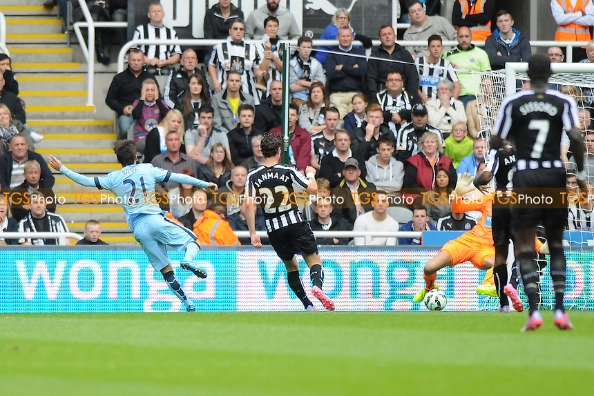 David Silva of Manchester City scores the opening goal of the game - Newcastle United vs Manchester City - Barclays Premier League Football at St James Park, Newcastle upon Tyne - 17/08/14 - MANDATORY CREDIT: Steven White/TGSPHOTO - Self billing applies where appropriate - contact@tgsphoto.co.uk - NO UNPAID USE