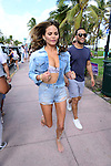 MIAMI BEACH, FL - FEBRUARY 20: Christine Teigen and John Legend  participates in Sports Illustrated Swimsuit 2014 Beach Volleyball:Models & Celebrity Chefs on February 20, 2014 in Miami Beach, Florida. (Photo by Johnny Louis/jlnphotography.com)