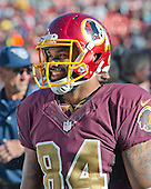 Washington Redskins tight end Niles Paul (84) smiles as he leaves the field following the game against the Tennessee Titans at FedEx Field in Landover, Maryland on Sunday, October 19, 2014.  The Redskins won the game 19 - 17.<br /> Credit: Ron Sachs / CNP