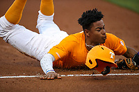 Tennessee Volunteers outfielder Zach Daniels (5) slides into third base against Tennessee Tech at Lindsey Nelson Stadium in Knoxville, Tennessee, on April 25, 2018. Tennessee Tech beat Tennessee 7-6. (Danny Parker/Four Seam Images)