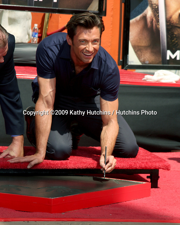 Hugh Jackman at the Hugh Jackman Handprint & Footprint Ceremony at Grauman's Chinese Theater Forecourt in Los Angeles,  California on April 21, 2009.©2009 Kathy Hutchins / Hutchins Photo....                .