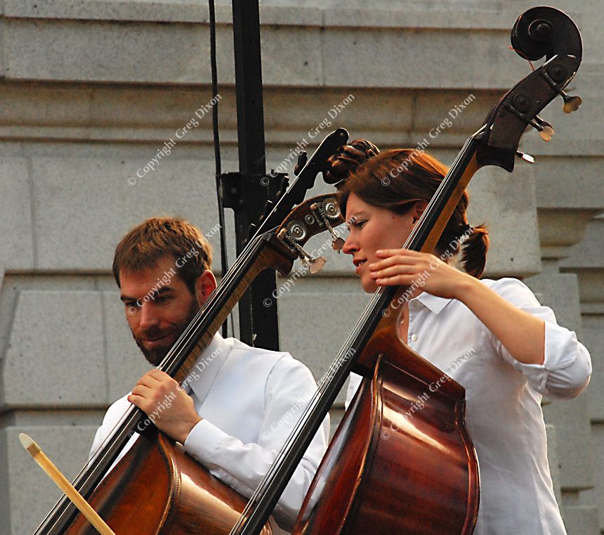 The Wisconsin Chamber Orchestra strings section prepares for the 2007 season of Concerts on the Square with a dress rehearsal Monday on the Capitol steps