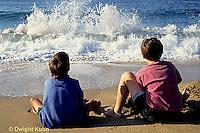 ON03-012z  Ocean - boys sitting on sandy beach watching waves breaking