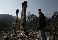 Avalon resident Bradley Wilson stands at what was his home Friday morning, May 11, 2007. Bradley works for Santa Catalina Island Company as their VP and Chief marketing officer, he and his wife and two children evacuated their Quail Canyon Road home Thursday afternoon as the fast moving fire threatened the city of Avalon.