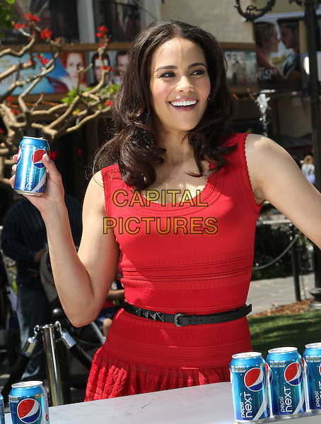 "Paula Patton.Paula Patton Invites Fans To Sample New Pepsi Next For ""Drink It To Believe It"" Campaign Held at The Grove, Los Angeles, California, USA..April 9th, 2012.half length red sleeveless dress black belt can.CAP/ADM/KB.©Kevan Brooks/AdMedia/Capital Pictures."