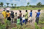 Children watching a United Methodist mission airplane taking off.