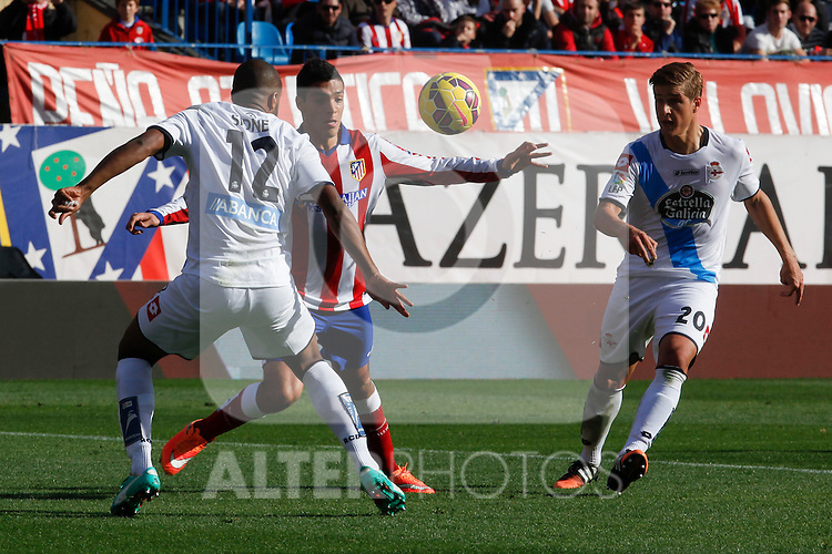 Atletico de Madrid´s Raul Jimenez (C) and Deportivo de la Coruña´s Sidnei and Wilk during 2014-15 La Liga match between Atletico de Madrid and Deportivo de la Coruña at Vicente Calderon stadium in Madrid, Spain. November 30, 2014. (ALTERPHOTOS/Victor Blanco)