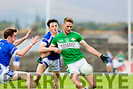 Billy McGuire gets in his shot on goal under pressure from Cormac Coffey Kerins O'Rahillys during their County Championship quarter final in Fitzgerald Stadium on Saturday