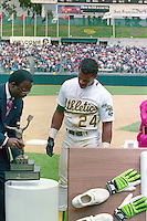 OAKLAND, CA - Rickey Henderson of the Oakland Athletics gets a trophy from Lou Brock after setting the all time career stolen base record by stealing base #939 during a game against the New York Yankees at the Oakland Coliseum in Oakland, California on May 1, 1991. Photo by Brad Mangin
