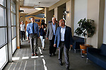 From left, University of Nevada, Reno Athletic Director Doug Knuth, Democratic governor candidate Steve Sisolak, and Raiders president Marc Badain tour the campus in Reno, Nev., on Thursday, Aug. 16, 2018. The Raiders are considering several potential training camp locations in Reno. (Cathleen Allison/Las Vegas Review-Journal)