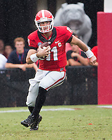 The Georgia Bulldogs played North Texas Mean Green at Sanford Stadium.  After North Texas tied the game at 21 early in the second half, the Georgia Bulldogs went on to score 24 unanswered points to win 45-21.  Georgia Bulldogs quarterback Aaron Murray (11)