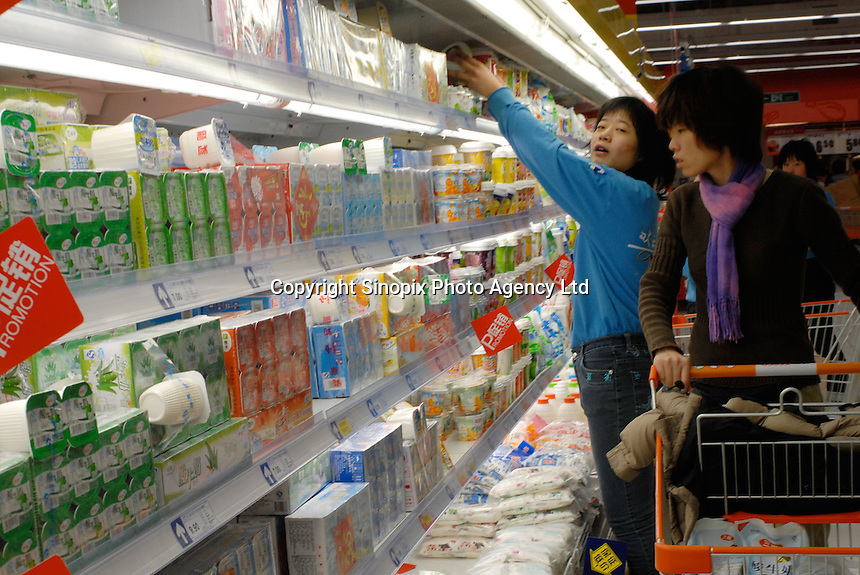 Yoghurt and dairy products at the Tesco supermarket that recently opened in Beijing, China. Tesco has joined with Ting Hsin, a 25-strong, upscale hypermarket based in the Shanghai region, in a deal worth £140m last year and has started re-branding and opening the stores with the familiar Tesco logo..27 Jan 2007