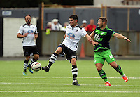 Pictured: Kyle Copp of Swansea (R) challenges a Merthyr Town player Saturday 11 July 2015<br />