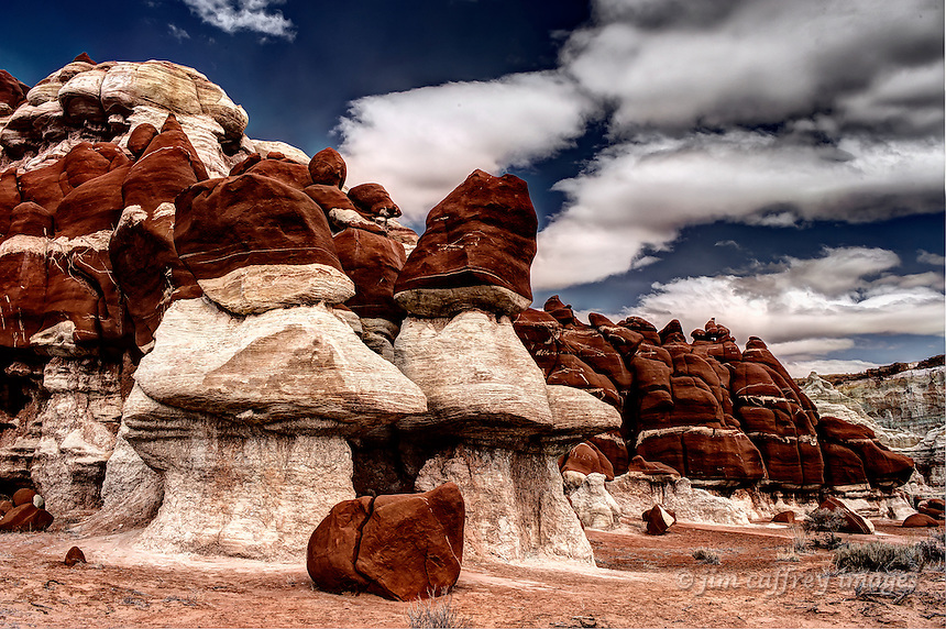 A collection of red and white sandstone hoodoos in Blue Canyon on the Hopi Reservation in northeastern Arizona.