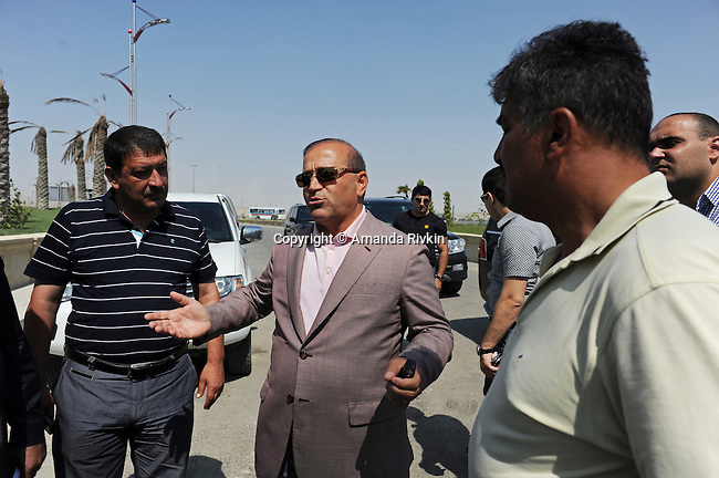 (Center) Ibrahim Ibrahimov, an Azerbaijani oligarch and billionaire, is seen on site of the of the Khazar Islands project near Sahil, Azerbaijan on July 18, 2012.  The brainchild of Ibrahimov, the artificial Khazar Islands project just southwest of the Azerbaijani capital Baku is being built at a projected cost of $100 billion with an anticipated 800,000 housing units.