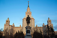 A statue of Mikhail Lomonosov stands in front of the main building of Moscow State University in Moscow, Russia.
