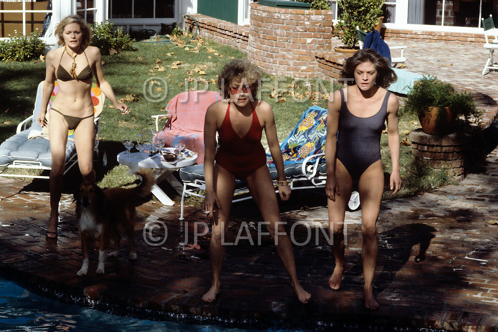 Los Angeles, CA, Summer 1982. The Osterman Weekend is a 1983 suspense thriller film directed by Sam Peckinpah. The film stars Rutger Hauer, John Hurt, Burt Lancaster, Dennis Hopper, Meg Foster and Craig T. Nelson. It was Peckinpah's final film before his death in 1984. Swiming pool scene in photo from left to right Helen Shaver, Cassie Yates and Meg Foster.