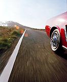 USA, California, Bolinas, 1965 Ford Mustang speeding down Hwy 1 between Muir Beach and Bolinas