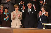 Doctor Adnan Pachachi, President, Iraqi Governing Council, and President of the Iraqi Independent Grouping acknowledges the applause during the State of the Union Address at the United States Capitol in Washington, DC on January 20, 2004.  He is former Foreign Minister and Permanent Representative to the United Nations. From left to right: Ms. Rend Al-Rahim (Iraqi Senior Diplomatic Rep); Mrs. Laura Bush; Dr. Adnan Pachachi; and Sister Carol Keehan (Religious Community).<br /> Credit: Ron Sachs / CNP