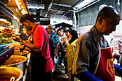 Locals wait for their turn at the famous Nasi Kandar at Line Clear in Georgetown in Penang, Malaysia. Photo: Sanjit Das/Panos