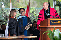 President Jonathan Veitch and Professor Anthony Chase confer an Honorary Degree to speaker Sara El-Amine '07<br /> Families, friends, faculty, staff and distinguished guests celebrate the class of 2018 during Occidental College's 136th Commencement ceremony on Sunday, May 20, 2018 in the Remsen Bird Hillside Theater.<br /> (Photo by Marc Campos, Occidental College Photographer)