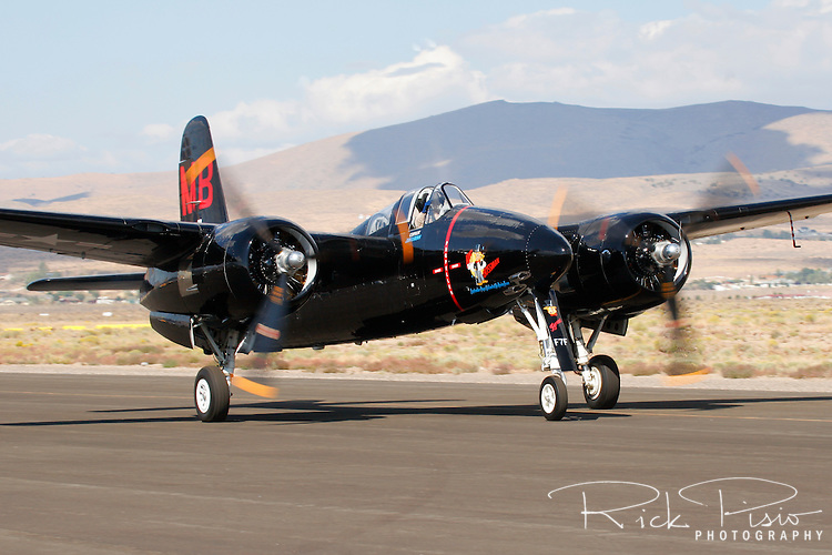 A Grumman F7F Tigercat owned by Mike Brown is taxied along the ramp prior to departure from Stead Field in Nevada after the conclusion of the 2007 Reno National Championship Air Races. There were 364 of the twin engined fighters built during World War II, and shortly thereafter, of which there are six that are still considered airworthy. Originally Grumman had been contracted to build 500 of the aircraft for use by the US Marine Corps to be used as close air support of the landing operations that were planned in the Pacific. Photographed 09/07