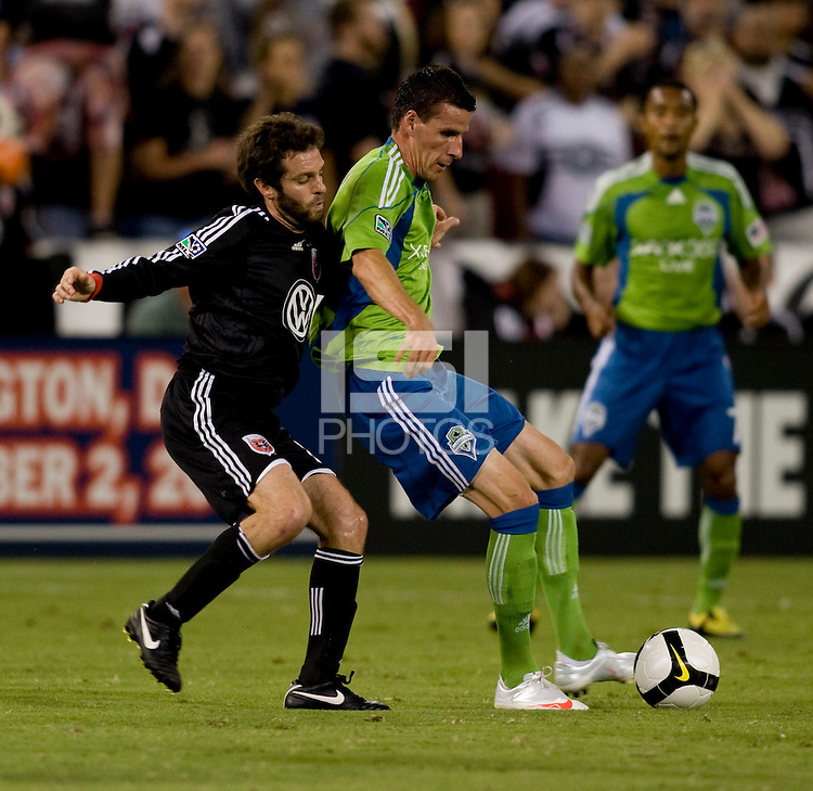 Ben Olsen, Sebastien Le Toux. The Seattle Sounders defeated DC United, 2-1, to win the 2009 Lamr Hunt U.S. Open Cup at RFK Stadium in Washington, DC.