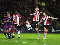 Lincoln City's Lee Frecklington has a shot from the edge of the box<br /> <br /> Photographer Andrew Vaughan/CameraSport<br /> <br /> The Emirates FA Cup Second Round - Lincoln City v Carlisle United - Saturday 1st December 2018 - Sincil Bank - Lincoln<br />  <br /> World Copyright © 2018 CameraSport. All rights reserved. 43 Linden Ave. Countesthorpe. Leicester. England. LE8 5PG - Tel: +44 (0) 116 277 4147 - admin@camerasport.com - www.camerasport.com