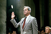 Robert C. McFarlane, former National Security Advisor to United States President Ronald Reagan, is sworn-in to testify before the joint US Senate and US House committee investigating the Iran-Contra Affair on Capitol Hill in Washington, DC on July 14, 1987.<br /> Credit: Ron Sachs / CNP