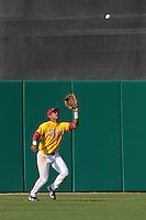 Omar Cotto Lozada (11) of the USC Trojans settles under a fly ball during a game against the Jacksonville Dolphins at Dedeaux Field on February 19, 2012 in Los Angeles,California. USC defeated Jacksonville 4-3.(Larry Goren/Four Seam Images)