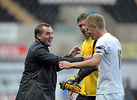 ATTENTION SPORTS PICTURE DESK<br /> Pictured L-R: A delighted Brendan Rodgers, manager for Swansea congratulates his players, Dorus de Vries goalkeeper and captain Garry Monk<br /> Re: Npower Championship, Swansea City Football Club v Leicester City at the Liberty Stadium, Swansea, south Wales. Saturday 23 October 2010