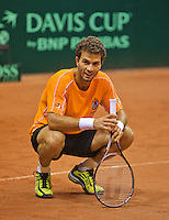 10-09-13,Netherlands, Groningen,  Martini Plaza, Tennis, DavisCup Netherlands-Austria, Training, Jean-Julien Rojer is resting (NED)<br /> Photo: Henk Koster
