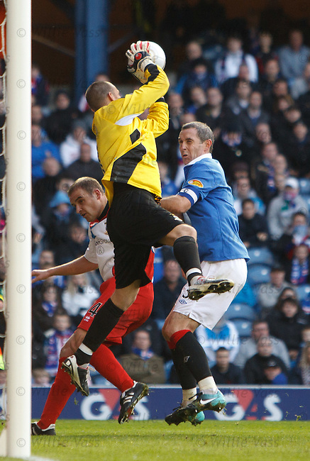David Weir pulls out of a challenge on keeper Ryan Esson but still gets booked by Iain Brines
