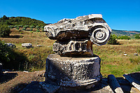 Ionic capital of the Temple of Artimis Sardis, originally the fourth largest Ionic temple when it was originally built in 300 B.C. In 150 AD under Roman rule when the worship  of the Emperor required all Roman cities to have a Temple dedicated to the Imperial family. The temple of Artimis was split into two sections with one half for Artemis and the Empress Faustina and the other for Zeus and Emperor Antoninus Pius and the present construction shows elements of Greek and Roman styles. Sardis archaeological site, Hermus valley, Turkey.