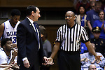 30 November 2014: Duke head coach Mike Krzyzewski (left) talks with referee Michael Stephens (right). The Duke University Blue Devils hosted the West Point Military Academy Army Black Knights at Cameron Indoor Stadium in Durham, North Carolina in a 2014-16 NCAA Men's Basketball Division I game. Duke won the game 93-73.