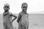 Samburu blacksmith children.   <br /> Samburu district. <br /> The clan of the blacksmith live away from the rest of the community as they are considered to have supernatural powers.