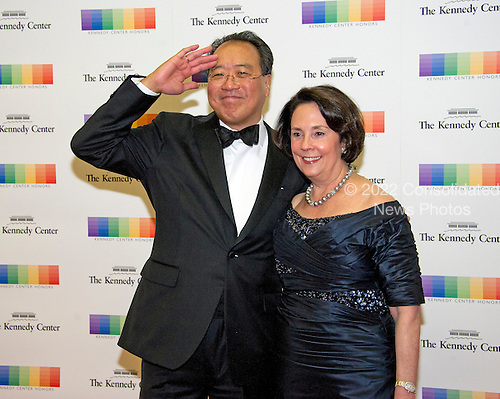 Yo-Yo Ma salutes the photographers as he and a guest arrive for the formal Artist's Dinner honoring the recipients of the 39th Annual Kennedy Center Honors hosted by United States Secretary of State John F. Kerry at the U.S. Department of State in Washington, D.C. on Saturday, December 3, 2016. The 2016 honorees are: Argentine pianist Martha Argerich; rock band the Eagles; screen and stage actor Al Pacino; gospel and blues singer Mavis Staples; and musician James Taylor.<br /> Credit: Ron Sachs / Pool via CNP